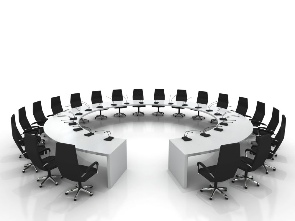 conference table and chairs with microphones