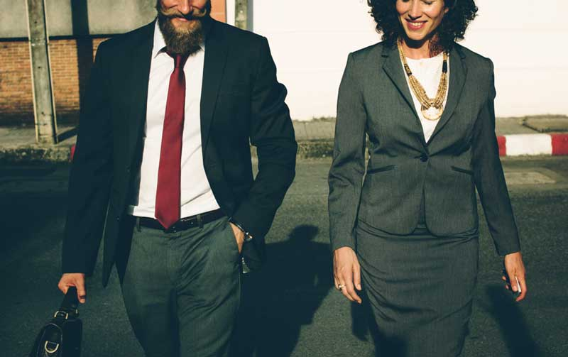 Man-and-Women-Walking-to-a-Business-Presentation