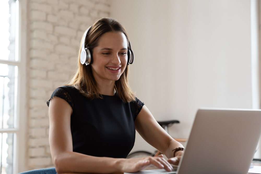 Young woman with headphones on webinar