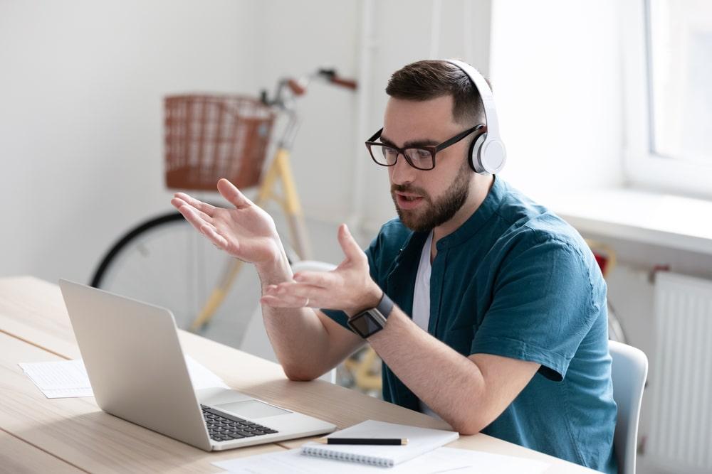 Man on laptop on webinar