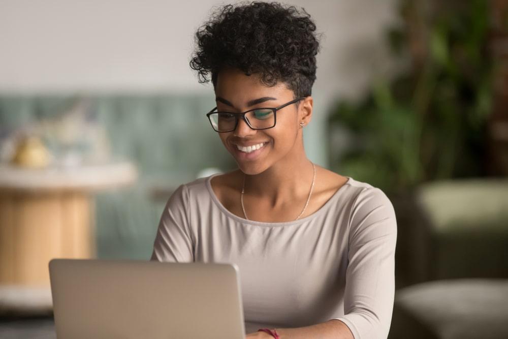 Woman on laptop on webinar