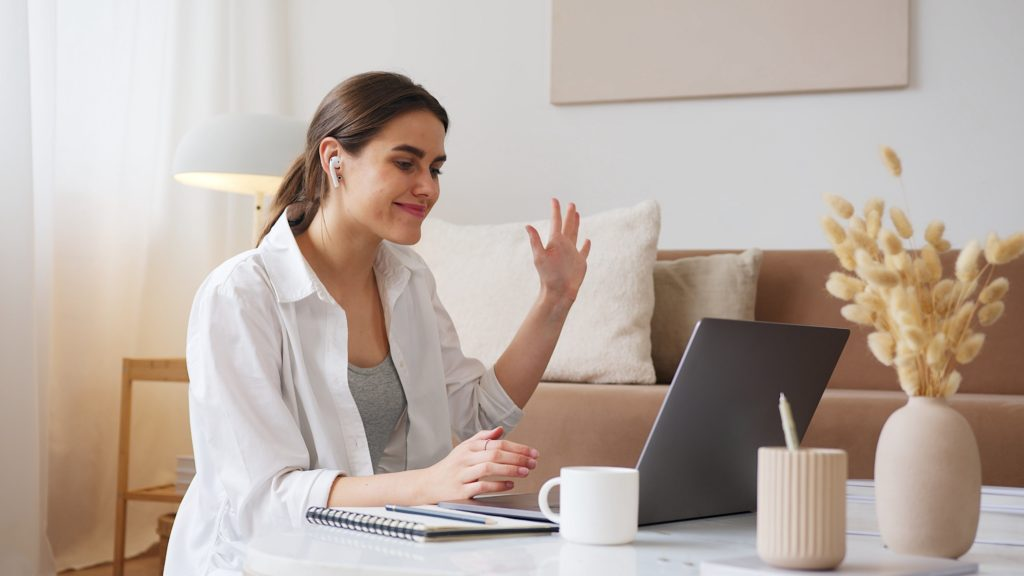 Woman presenting a webinar on laptop