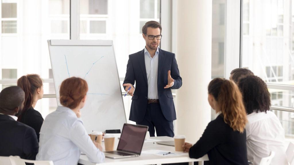 A business presenter receiving an assessment of their ability