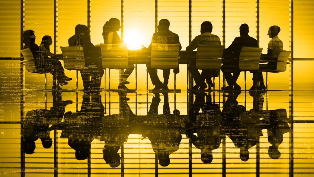 board of senior executives awaiting a presentation